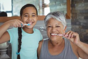 Grandmother and Child Brushing Teeth